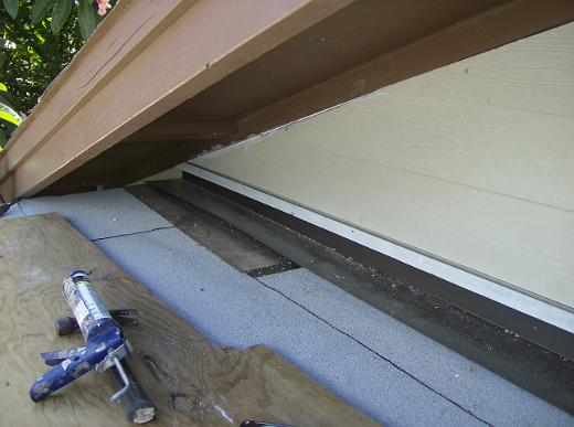 Homefront makeover with deck extensions for Window z flashing